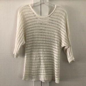 White short sleeve light sweater.